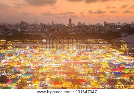 Top View Flea Weekend Market With City Downtown And Sunset Sky Background