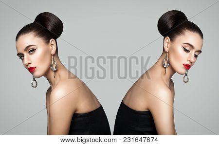 Two Fashion Girls. Twins Portrait On Gray