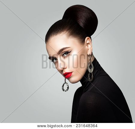 Perfect Young Woman Fashion Model. Girl With Hair Updo And Red Lips Makeup