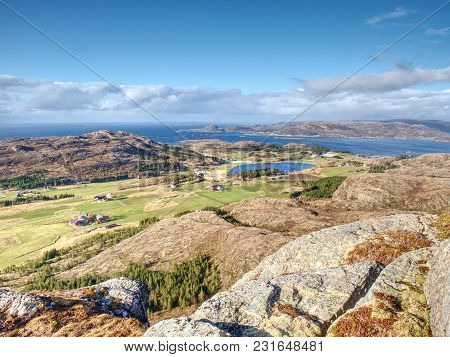 View From Mountain Peak To The Picturesque Valley And Fjord.  Aerial View To Bay With Fishing Villag