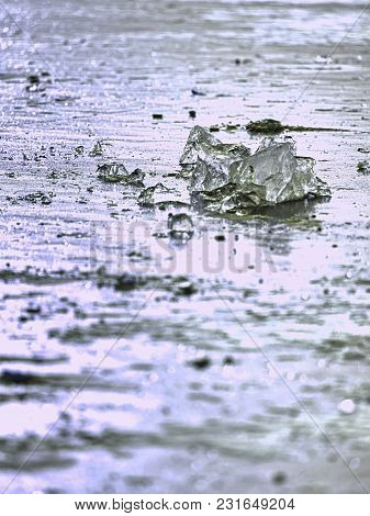 Sparkling Shards Of Cracked Ice Jut Out On The Frozen Lake. The Light Effect Occurs In Deep And Shal