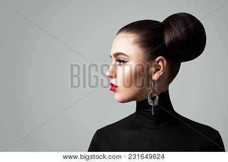 Pretty Young Woman With Hair Bun Hairstyle, Profile Portrait