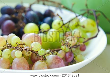 Red, Green And Blue Grapes At Plate