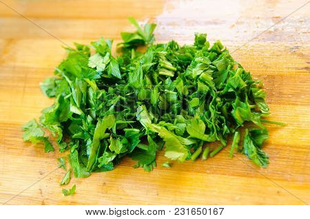 A Chopped Parsley At The Wooden Board