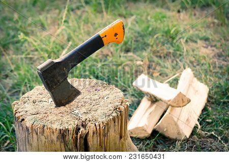 An Old Ax In A Stump Log