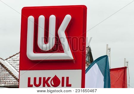 Miercurea Ciuc , Romania- 18 March 2018: Frozen Lukoil Logo At The Gas Station On Cold Spring Day.