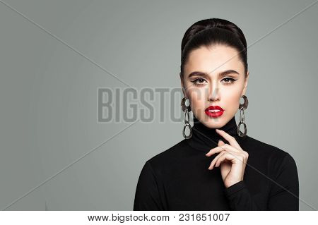 Fashion Portrait Of Young Model Woman. Makeup. Trendy Hairstyle. Beauty Salon Background