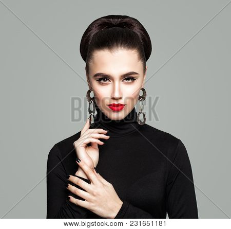 Nice Woman With Healthy Hair And Makeup. Portrait.