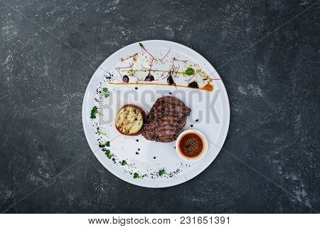 Steak Pepper From Veal With Grilled Vegetables, Served In A Ceramic White Plate With Grey Plastered