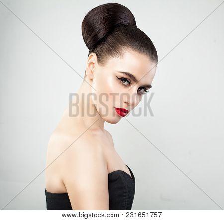 Beautiful Female Model Face. Elegant Young Woman Portrait.