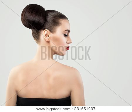Female Back And Profile. Woman With Updo Hair