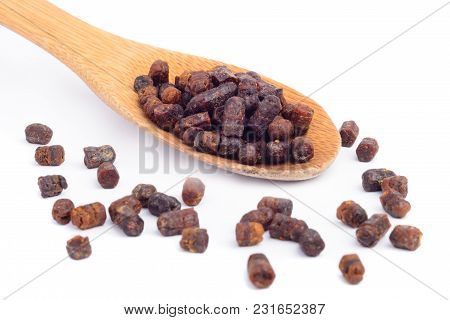 Granules Of Bee Bread In A Wooden Spoon Are Isolated On A White Background. Apitherapy. Beekeeping P