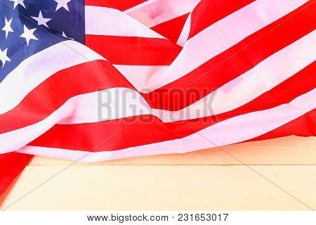 American Flag Over Whitewashed Wood Background For United States Holidays