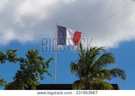 The French Flag Hoisted On A Top Of Fort Saint Louis, Martinique Island , French West Indies.