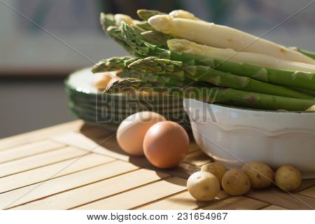 Raw Uncooked Fresh White And Green Asparagus With Eggs And Potatoes, Ready To Cook For Dinner