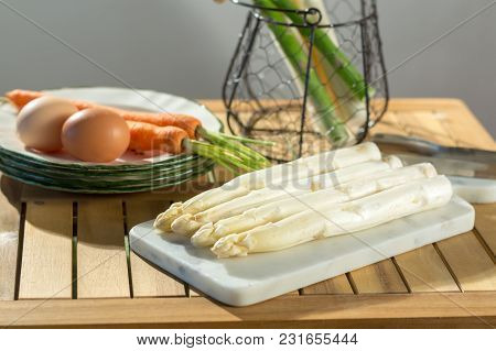 Raw Uncooked Fresh White And Green Asparagus With Eggs And Carrots, Ready To Cook For Dinner