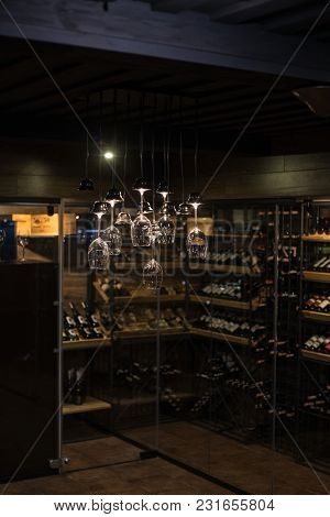 Wine Cellar In An Expensive Luxury Restaurant And A Fashionable Chandelier In The Form Of Glasses.