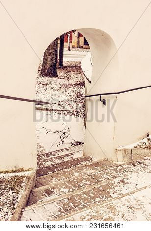 Shallow Stairs And An Historic Gate With Railing. Detailed Architectural Scene. Yellow Photo Filter.
