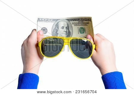 A Teenager Holds One Hundred Dollars With Two Hands And A Sunglasses Isolated On A White Background