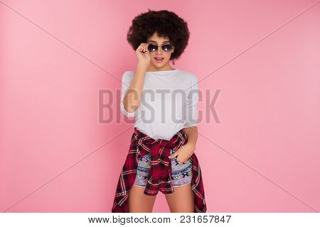 Be Into Trends! Gorgeous Good-looking Young Girl In Sunglasses Looking Straight And Posing For The P