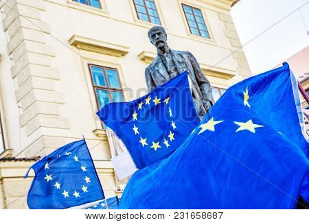 Statue Of Tomas Garrigue Masaryk And European Union Flags In Castle Area, Prague, Czech Republic. Sy