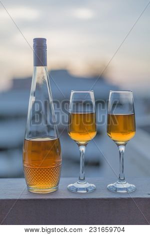 Single Bottle With Liquor And Two Glasses