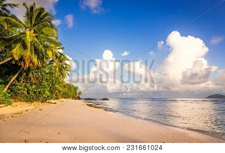 Idyllic Scenery Of Sandy Beach And Turquoise Indian Ocean In The Seychelles