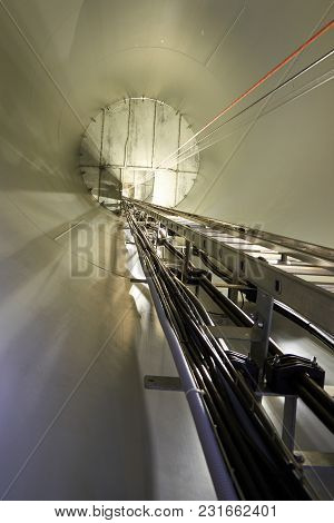 Inside The Wind Turbines. A Wind Farm Is A Group Of Wind Turbines In The Same Location Used For Prod