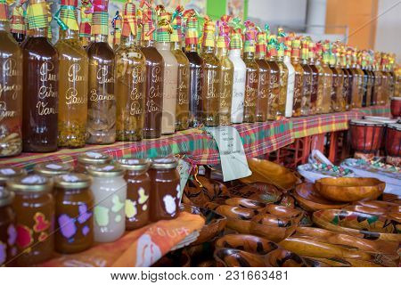 Souvenirs Of Caribbean: Assortment Of Jams And Fruit Flavored Punch In Caribbean Market Stall. Home