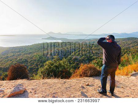 Man Looking At Sunrise On Mediterranean Sea, Sardinia, Italy