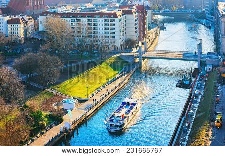 Cityscape And Excursion Ship On Spree River In Berlin, Germany