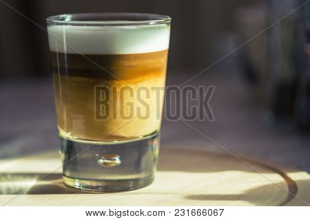 Coffee Latte Macchiato Cup With A Frothy Milk And Bubbles