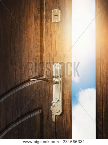 Half Open Door With Keys In Keyhole. Doorway To Heaven And Success. Entrance Or Exit, Dreams And Fre