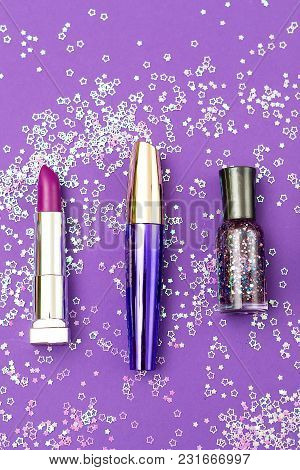 Set Of Professional Decorative Cosmetics On Ultra Violet Background. Vertical