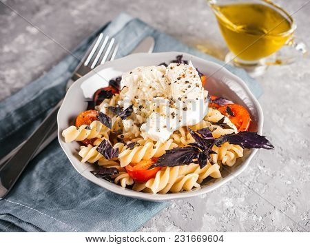 Tasty Italian Fusilli Pasta With Cherry, Mozarella Or Buratta Cheese And Fresh Basil. Dish With Past