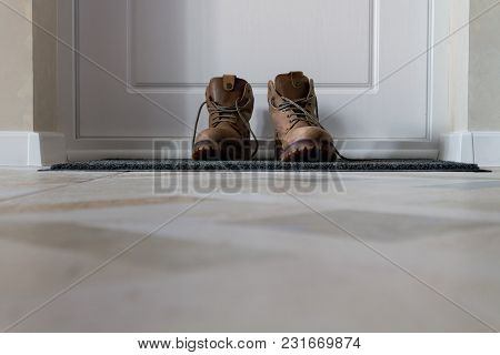 A Pair Of Men's Shoes On The Carpet In The Corridor