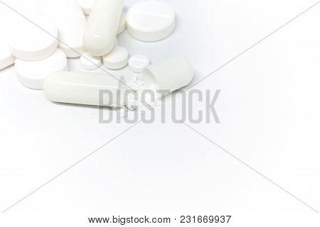 Many Different White Pills Isolated. Medical Concept