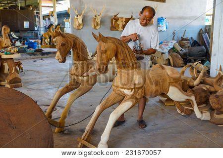 Lampang, Thailand - November 3, 2012: Craftsman Polishing Wooden Horse Sculpture With Polishing Mach
