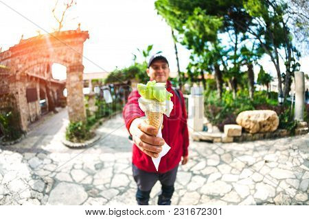 The Man Is Holding Ice Cream. A Refreshing Snack. Summer Treat. A Horn With Creamy And Fruity Ice Cr