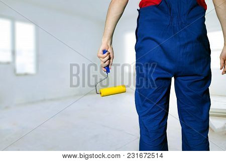 Construction Worker With Paint Roller Ready For Apartment Painting