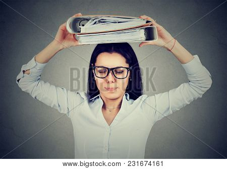 Stressed Business Woman Standing With Folders On Her Head Isolated On Gray Background