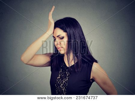 Regrets Wrong Doing. Woman, Slapping Hand On Head Having Duh Moment Isolated On Gray Background. Neg