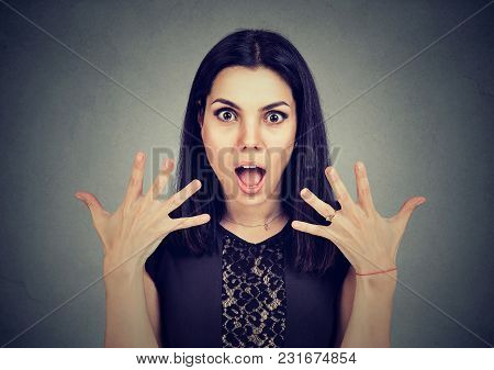 Portrait Of A Surprised Young Woman Looking At Camera