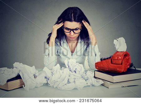 Too Much Work Stressed Woman Sitting At Her Disorganized Desk With Books And Many Paper Balls Isolat