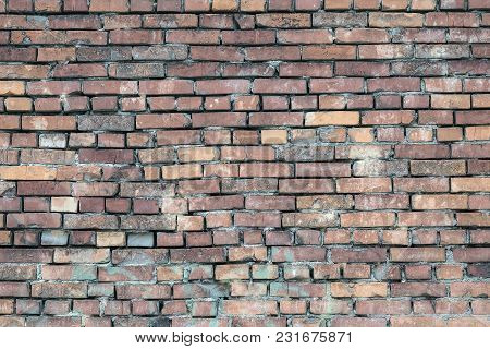Background Of The Old Brick Wall. Bricks Of Different Colors And Sizes Are Laid In One Wall. Some Of
