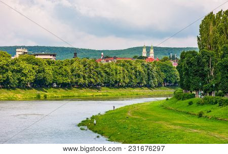 Part Of The Linden Alley On The Embankment Of River Uzh. Beautiful Sunny Summer Day In Uzhgorod Town