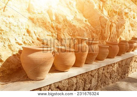 Many Large Clay Pots Standing In A Row