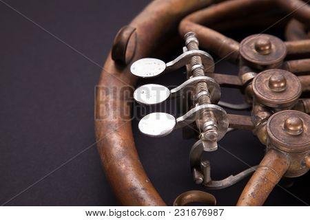 Vintage Bronze Pipes, Valve, Key Mechanical Elements French Horn, Black Background. Good Pattern, Pr