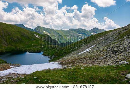 Beautiful Landscape In Fagarasan Mountains. Popular Travel Destination. Capra Lake Between Hills, Mo