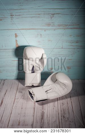 White Boxing Gloves On Blue And White Cracked Wooden Background, Empty Space